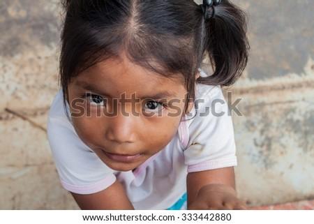 PANTOJA, PERU - JULY 12, 2015: Child living in small village Napo in amazonian jungle, Peru - stock photo