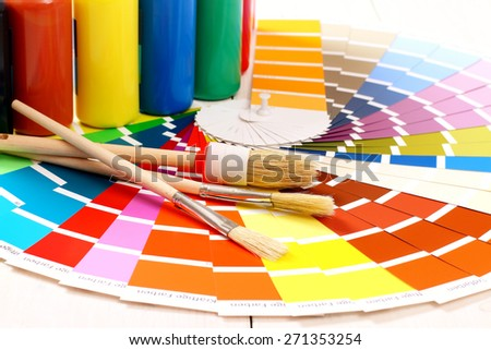 Pantone color palette, brush on white wooden background, close up