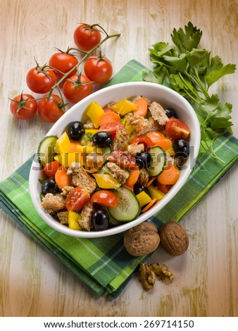 panzanella mixed salad with nuts and sliced bread