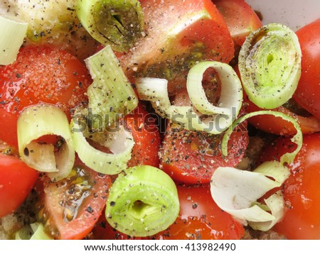 Panzanella salad from Tuscany with old bread, tomatoes, leek and pepper - stock photo