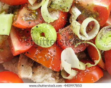 Panzanella salad from Tuscany with old bread, tomatoes, leek and pepper
