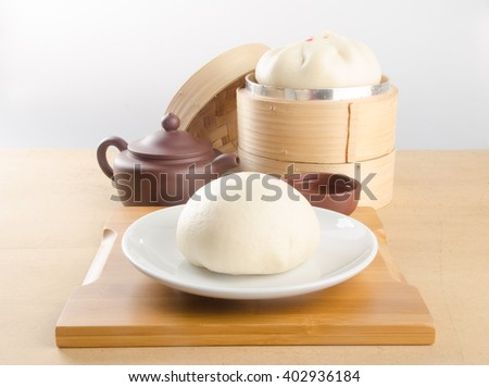 pao or dim sum in bamboo steamer with chinese bun