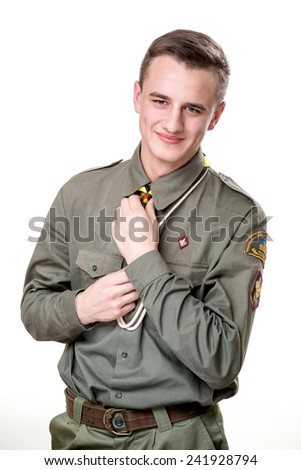 Paortrait of handsome scout man isolated on white background - stock photo