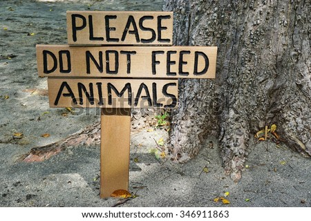 PAPAGAYO, COSTA RICA -25 NOVEMBER 2015- Wooden sign reading Please Do Not Feed the Animals.