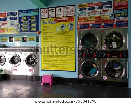 Papar, Sabah, Malaysia - November 13, 2017: Industrial washing machines in a public laundromat is now available in Papar Town.