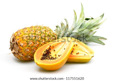 Papaya and pineapple photographed on a white background. - stock photo