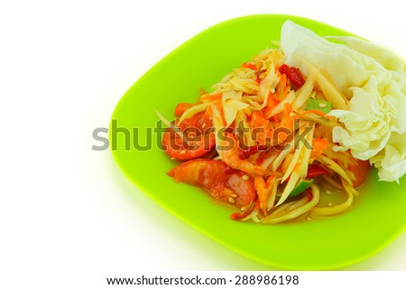 papaya salad, Thai cuisine spicy delicious on green plate - stock photo