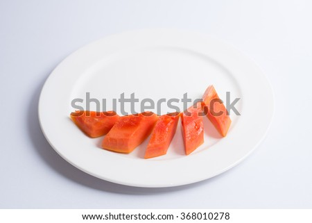 papaya with white dish background
