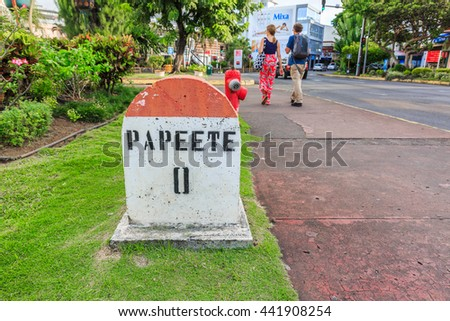 PAPEETE, FRENCH POLYNESIA - JUNE 23, 2016 :  A  Zero Kilometer stone on the road in the town of Papeete early in the morning in Tahiti  Papeete, French Polynesia on June 23, 2016
