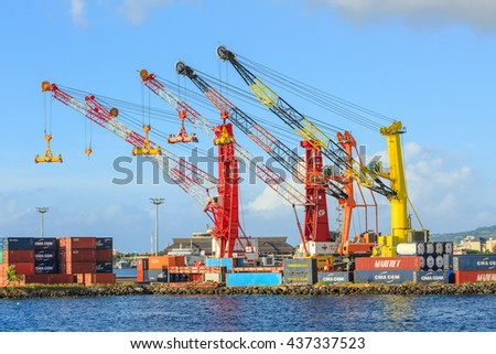 PAPEETE, FRENCH POLYNESIA - JUNE 14, 2016 :  The big cranes and Containers at Large commercial port  in Tahiti PAPEETE, FRENCH POLYNESIA on June 14, 2016