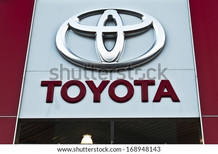 PAPENBURG - DEC 14: Toyota logo, December 14, 2013 in Papenburg, Germany. Toyota Motor Corporation is a Japanese automaker headquartered in Toyota, Aichi, Japan.