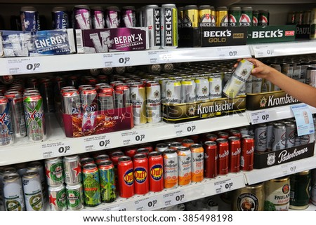 PAPENBURG, GERMANY - AUGUST 11, 2015: Aisle with a variety of Energy drinks and Radlers in cans in a Real Hypermarket. Real is a European hypermarket, member of the German retail giant Metro AG. - stock photo
