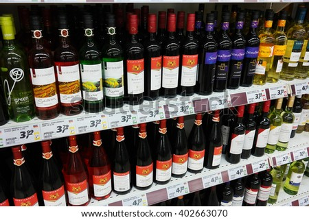 PAPENBURG, GERMANY - AUGUST 11, 2015: Shelves filled with in Germany produced Wines in a REAL hypermarket in Germany. Germany has about 102,000 hectares of vineyard. - stock photo