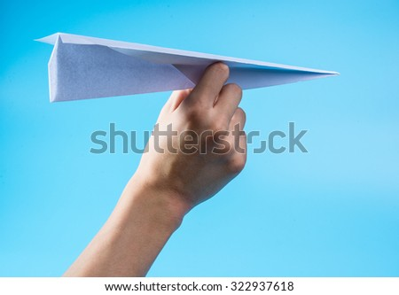Paper airplane and blue sky. - stock photo