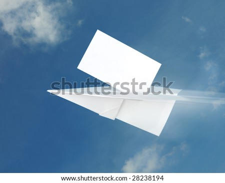 Paper airplane in the blue sky background - stock photo