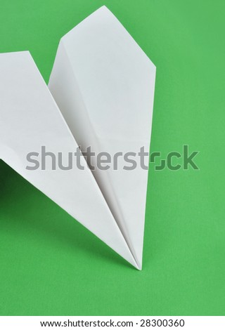 Paper airplane in the green background - stock photo
