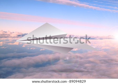Paper airplane in the sky - stock photo