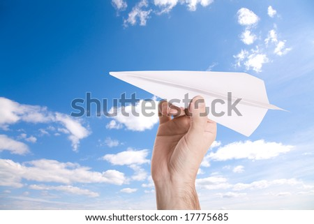 paper airplane on blue sky background