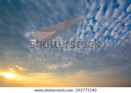 paper airplane Sunrise backdrop - stock photo
