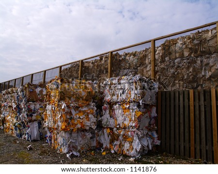 Paper and cardboard pressed in to bales for later recycling. Jutland, Denmark. - stock photo