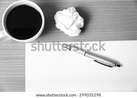 paper and crumpled with pen and coffee cup on wood background black and white color tone style - stock photo