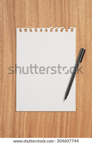 Paper and pen on wood table for text and background - stock photo