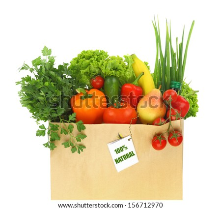 Paper bag full with fruits and vegetables  - stock photo