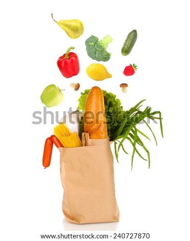 Paper bag with falling products isolated on white - stock photo