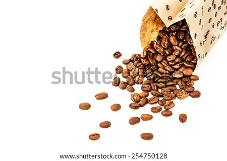 Paper bag with grain coffee on white background. coffee beans isolated on white background. roasted coffee beans, can be used as a background. - stock photo
