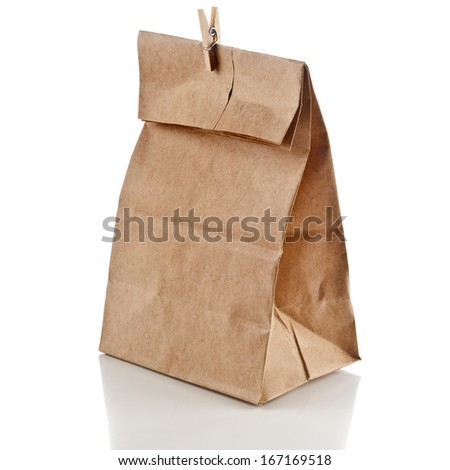 paper bag with small wooden clip  isolated on white background - stock photo