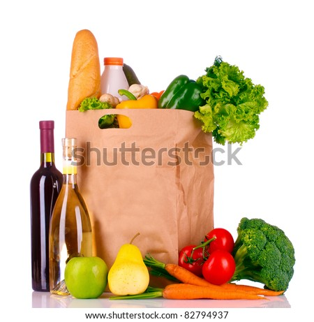 paper bag with vegetables and food isolated on white - stock photo