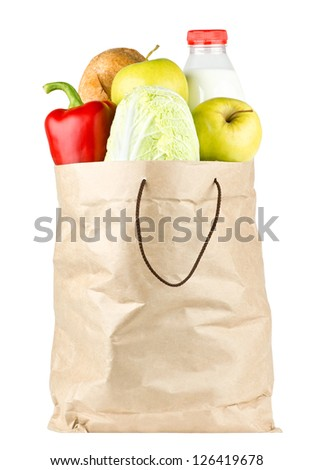 Paper bag with vegetables and food on white background - stock photo