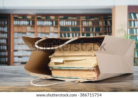 Paper bags with books in the library - stock photo