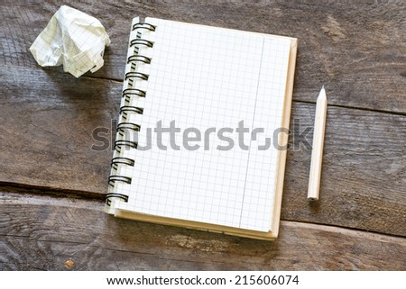 Paper ball and pen over blank white sheet - Creativity crisis concept