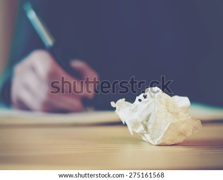 Paper ball during writing - stock photo