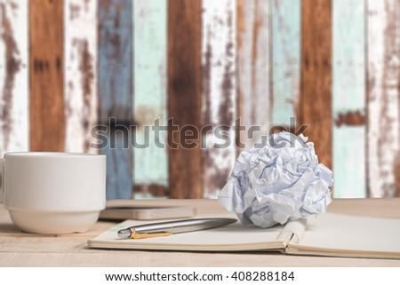 Paper balls and pen over blank white sheet - Creativity crisis concept - stock photo
