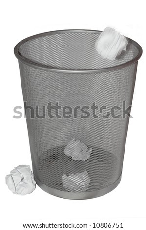 Paper being thrown into a rubbish bin. isolated on white - stock photo