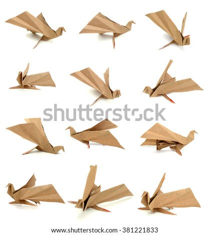 Paper birds on white background