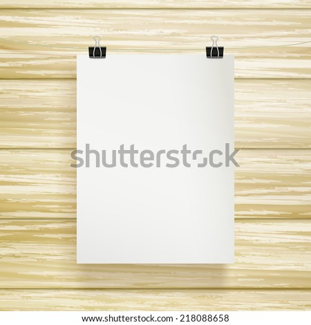 paper blank brochure template isolated over wood grain