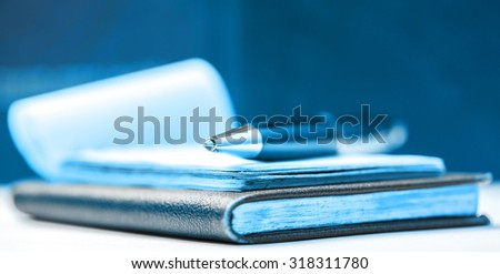 Paper blocks with pen in blue toning - stock photo