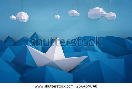 paper boat on paper waves - stock photo