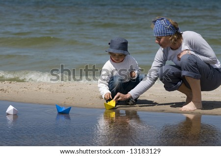 Paper boat race - stock photo