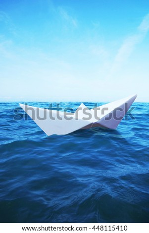 Paper Boat sails on the sea - stock photo