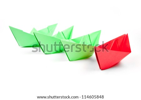 paper boats sailing in one direction isolated on white