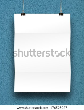 paper card on a blue wall