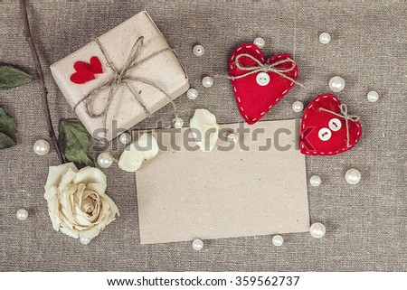 paper card with gift box, white rose, heart and pearls beads, valentines day card concept.