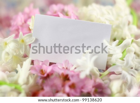 paper card with spring flowers - stock photo