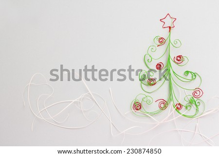 Paper christmas fir tree with red decoration on white background - stock photo
