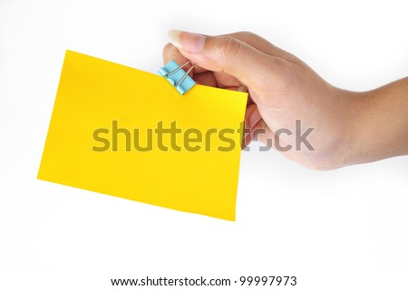 paper clip and yellow paper