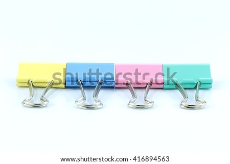 Paper clip Blue , yellow, green and pink isolated
